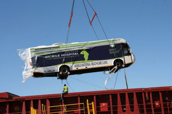 Mobile maternity clinic lifted by crane